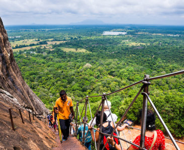Photo of tourists climbing Sigiriya Rock Fortress, aka Lion Rock, Sri Lanka. This is a photo of tourists climbing Sigiriya Rock Fortress, aka Lion Rock, a UNESCO World Heritage Site in Sri Lanka. Sigiriya Rock is easily the most popular tourist attraction in Sri Lanka.